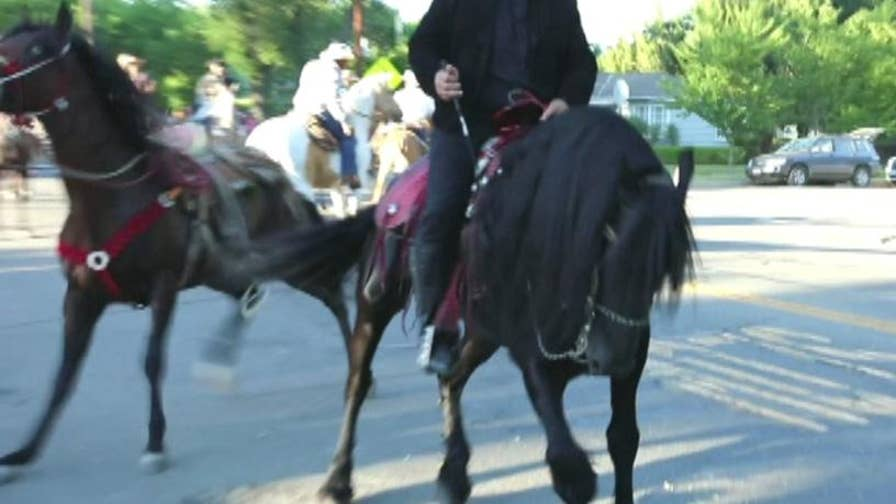 A man suspected to be intoxicated was arrested after his horse injured a boy at a parade in Colusa, California.