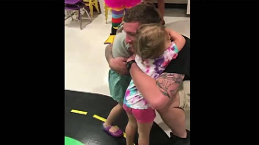 Two little girls in Florida were in for the perfect Father's Day surprise when their dad came home after being deployed for six months.