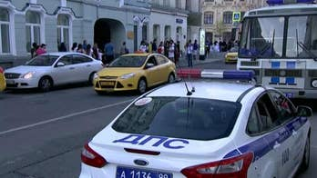 Authorities say taxi driver is in custody after crashing into crowd in Moscow as Russia hosts the World Cup.