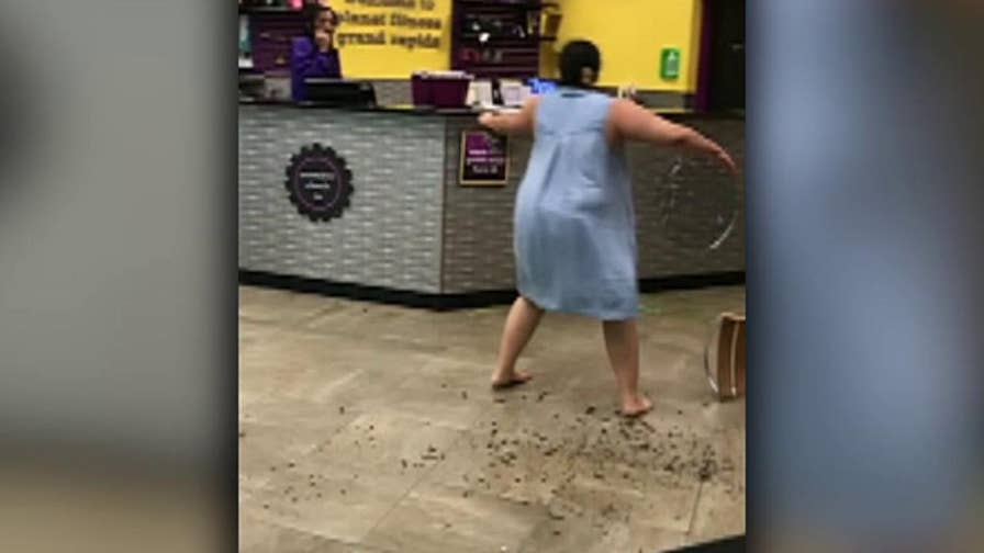Warning: Graphic language. Raw video: Woman damages equipment at a Planet Fitness in Michigan.
