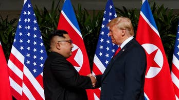 Pundits question talks with brutal dictator.