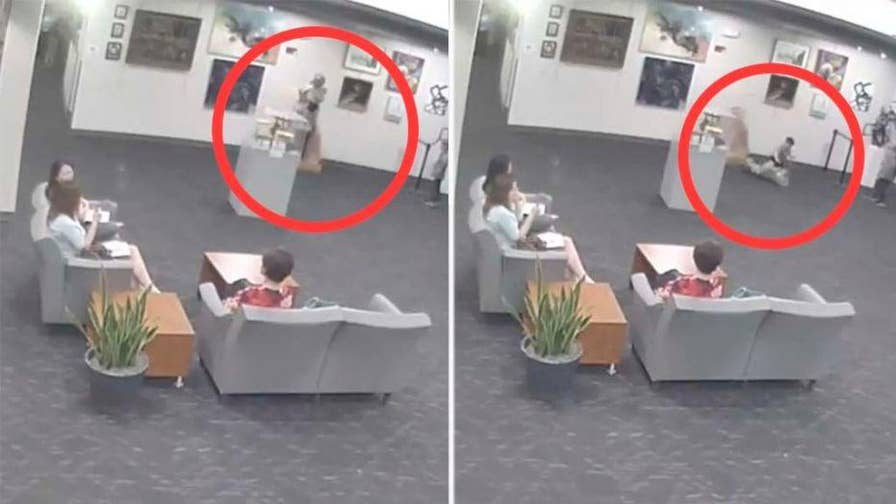 A city in Kansas is reportedly demanding $132,000 from the parents of a boy who knocked over a glass sculpture.
