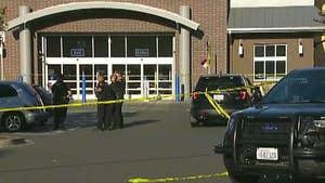 Suspect shot and killed in Walmart parking lot after leading police on chase.