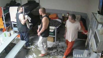 One man was captured and two are still at large after using a pipe to smash through a brick wall.
