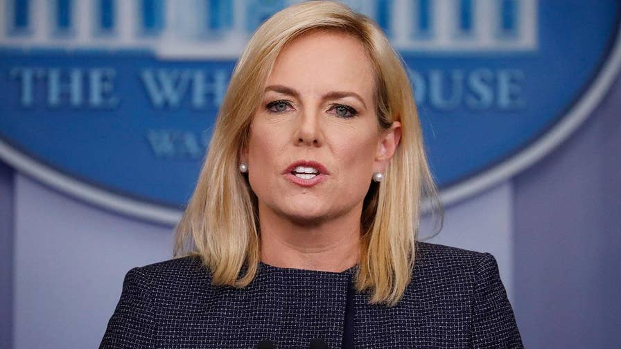 DHS secretary defends Trump administration's enforcement of immigration law, insists the separation of migrant families was also done under previous administrations.