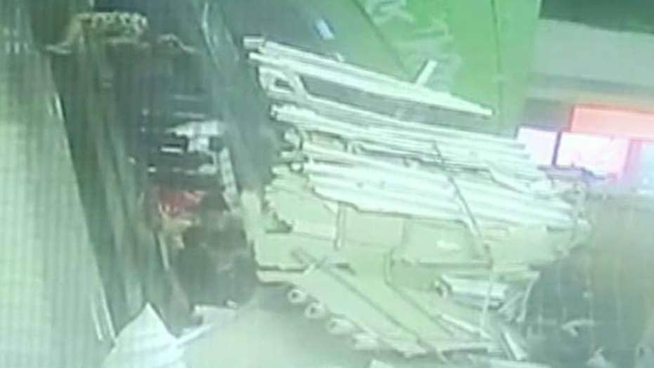 Roof collapses on top of packed escalator in China