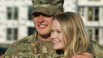U.S. Army Specialist Camryn Henley surprised girlfriend Madison Olinger by returning from deployment and then surprised her again with a ring.