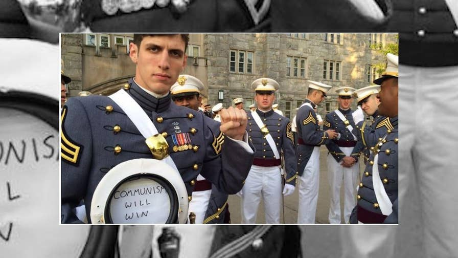 The West Point graduate who posed with a Communism cap is officially out of the U.S. Army. A look at why he was discharged.