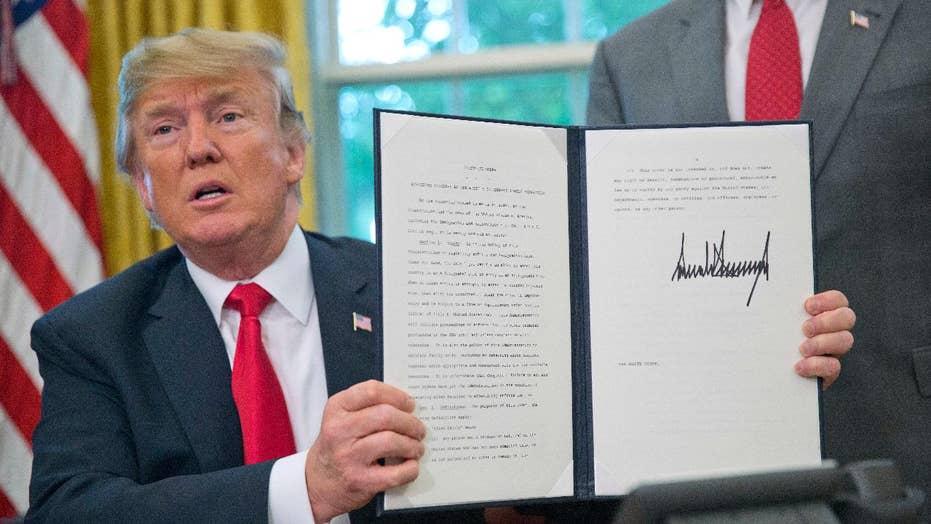 Trump signs order halting separation of families at border