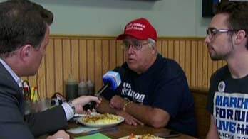 Voters at Minnesota's Uncle Loui's Café offer diverse opinions on the issue.