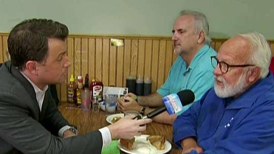 Todd Piro talks to diners in Duluth, Minnesota about President Trump's economy.