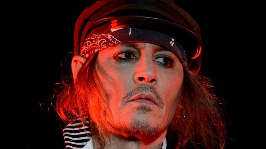 Johnny Depp opens up about his divorce and claims of his lavish spending.