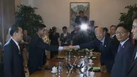 North and South Korea agreed Friday to hold temporary reunions of families divided by the 1950-53 Korean War as they boost reconciliation efforts amid a diplomatic push to resolve the North Korean nuclear crisis.