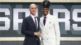 Lonnie Walker of the University of Miami Hurricanes became an Internet meme after donning a San Antonio Spurs cap that appeared to float on top of his high hairdo.