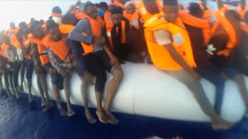 Raw video: German NGO Mission Lifeline shares footage of operators rescuing mother and child from crowded dinghy in the Mediterranean.