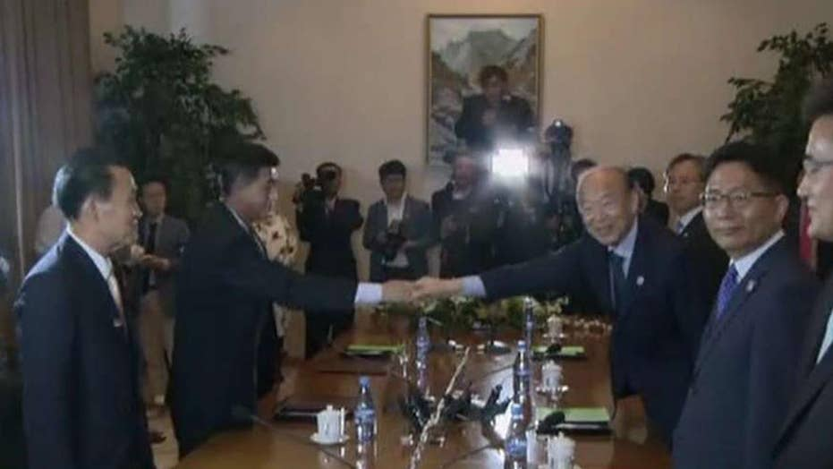 Korean officials agree to reunite families divided by war