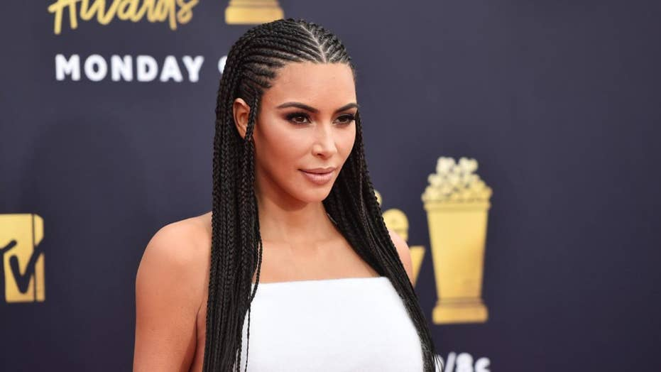 Kim Kardashian continues to defend her braids