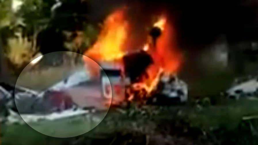 Problems with landing gear, fuel supply lead to crash killing two in Michigan. 17-year-old able to escape from the burning aircraft after good Samaritans broke a window to free him.