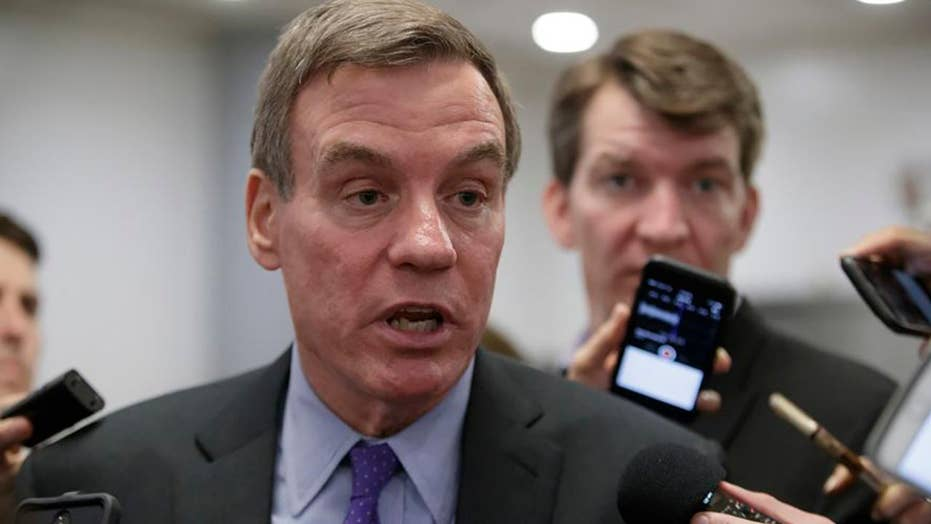 Report: Sen. Warner jokes about revealing Russia probe info