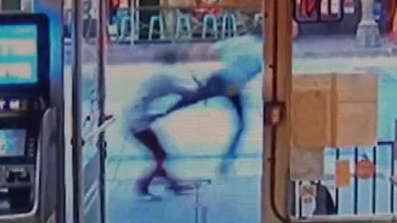 Video shows bystander taking out violent homeless man with impressive flying kick