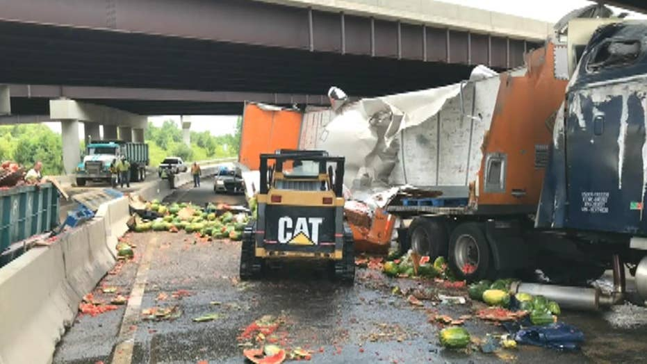 Raw video: Tractor-trailer carrying watermelons overturns