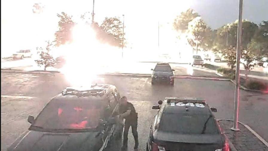 Parking lot camera captures close call in Apopka, Florida.