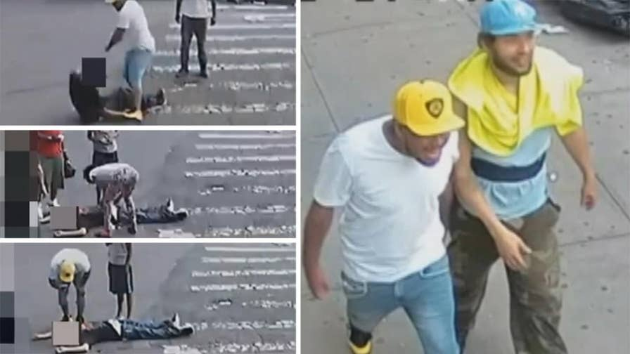Raw video: Attackers return to scene to take photos, passersby rob the unconscious victim while he lays in the street. NYPD seeks assistance identifying suspects.