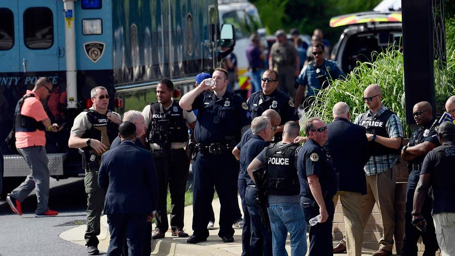 But officials are not releasing the suspect's name following deadly attack on the Capital Gazette newsroom which left at least five dead in Maryland.