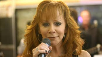 Reba McEntire's top ACM Awards moments, from her first award to hosting in slippers
