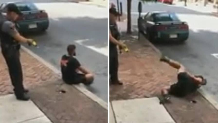 Raw video: Police officer in Lancaster, Pennsylvania uses Taser on man sitting on the sidewalk as shocked onlooker looks on and records the incident on his cell phone.
