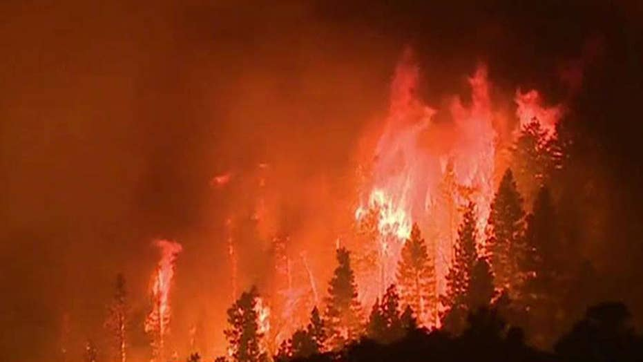 Crews battle wildfires in Western states