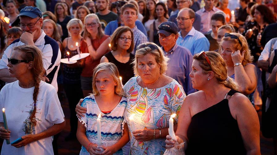 A community gathers together to mourn the loss of five people gunned down in Thursday's newsroom shooting. Lea Gabrielle reports.