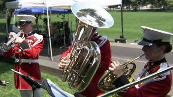 Band plays patriotic themes to celebrate Independence Day.