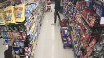 Surveillance footage shows the owner of Friendly Grocer in Australia defending the store against an attempted robbery by an ax-wielding man.