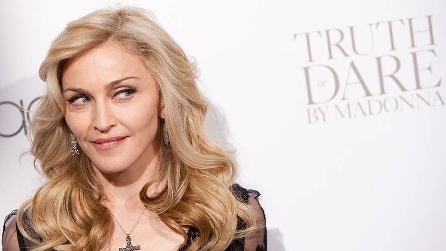 Manhattan Supreme Court Justice Gerald Lebovits said pop superstar Madonna was 'merely harassing' fellow residents of her Upper West Side co-op for continuing to seek records from the board after she lost a legal bid challenging a rule on her lease.
