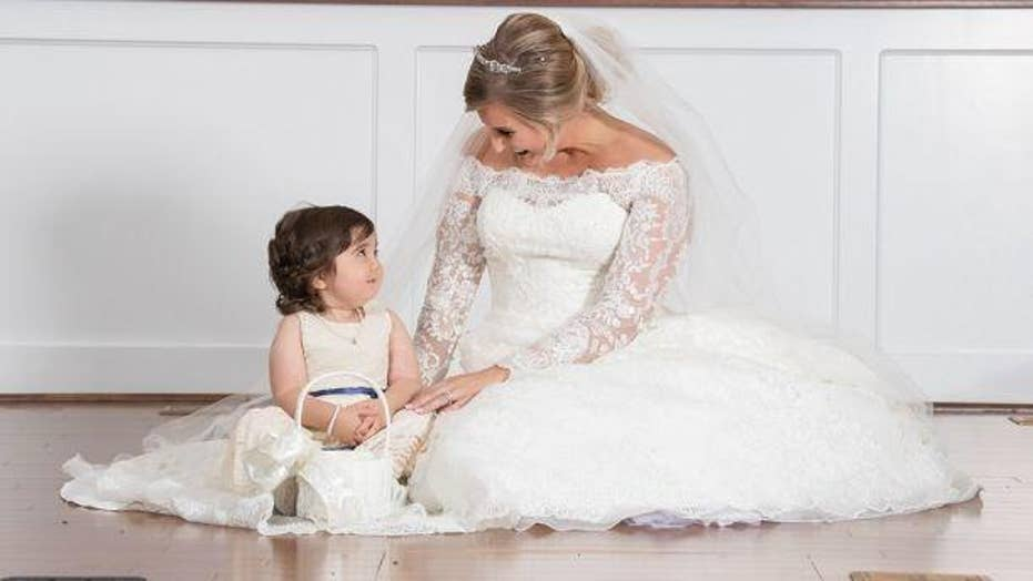 Girl battling cancer is the flower girl at her bone marrow donor's wedding