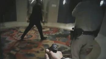 Raw video: Las Vegas Metro Police Department releases body cam footage as officers make way to Stephen Paddock's room at the Mandalay Bay hotel during the attack as automatic gunfire is heard in background.