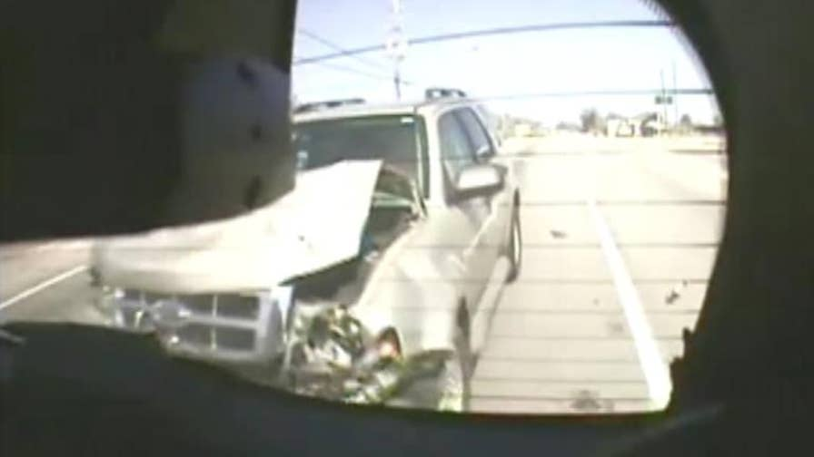 Raw video: Distracted driver rams into police car in Georgia.