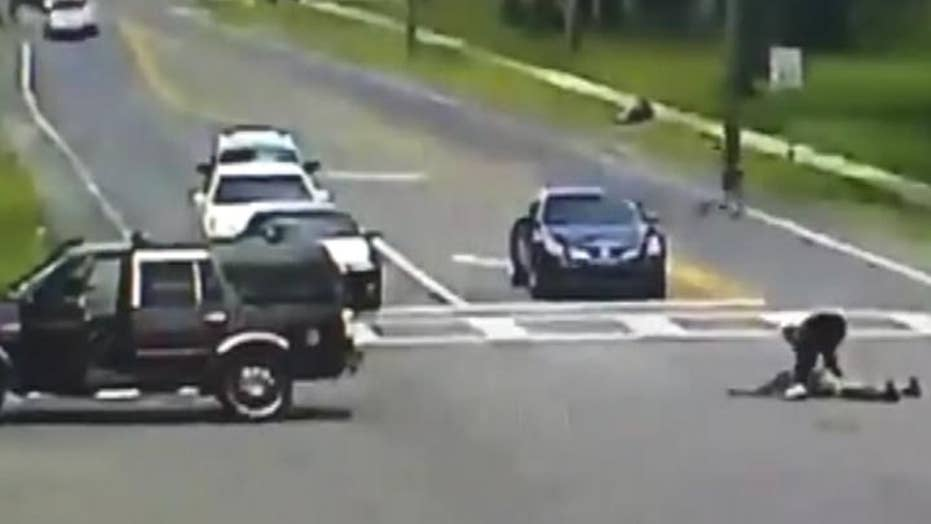 Warning, graphic content: Woman falls out of moving SUV