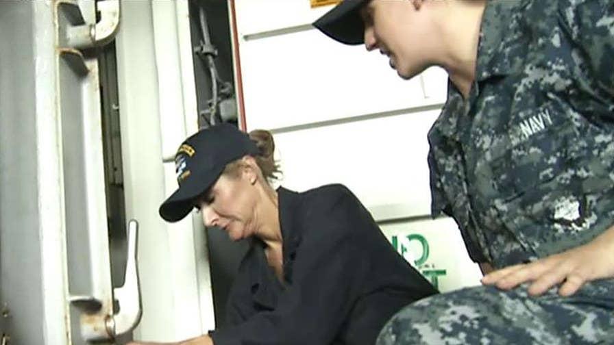 Former Navy fighter pilot Lea Gabrielle goes below deck.