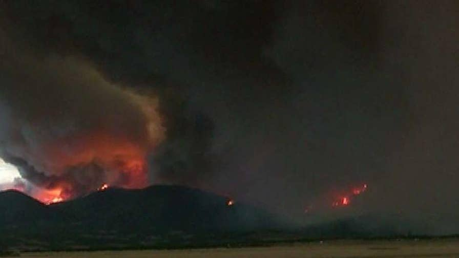 High temperatures, winds fueling flames; Marianne Rafferty reports on the ongoing battle.