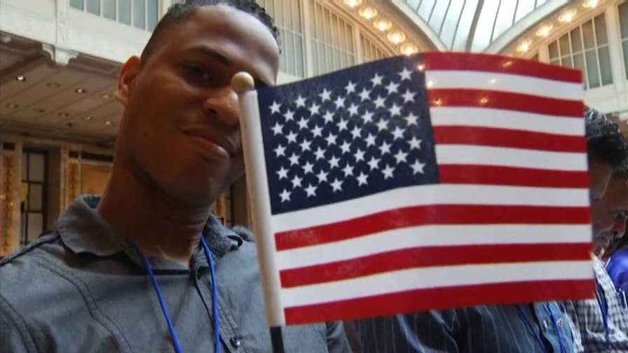 200 immigrants become naturalized citizens during an annual Independence Day naturalization ceremony at the New York Public Library.