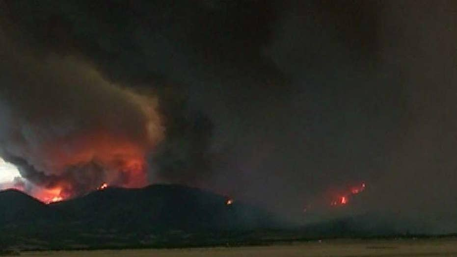 Dozens of wildfires raging in western states