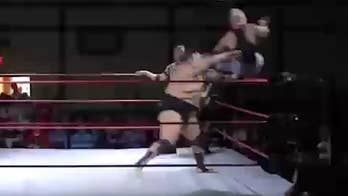 Raw video: Ace Romero hurls Anthony Gaines out of the ring over a dozen feet and into the crowd during an Empire State Wrestling's Summer of Sleaze event near Buffalo.