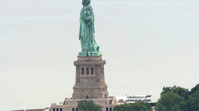 Woman scales Statue of Liberty in anti-ICE protest
