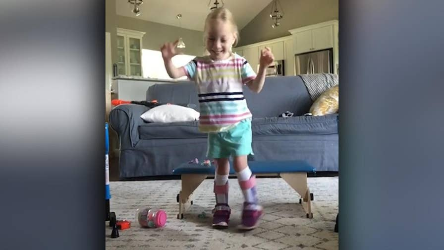 Raw video: Ecstatic little girl with cerebral palsy walks for first time on her own after undergoing major spinal procedure.