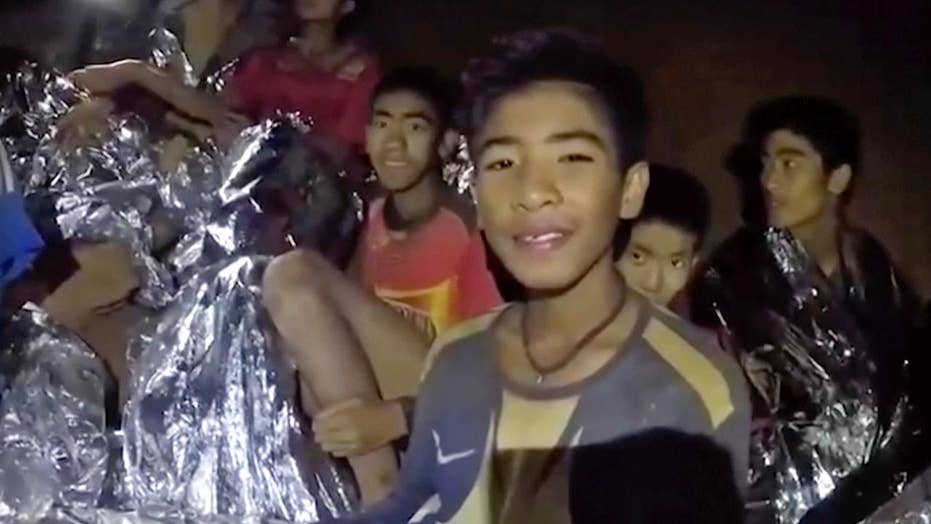 12 children, soccer coach trapped in cave in Thailand