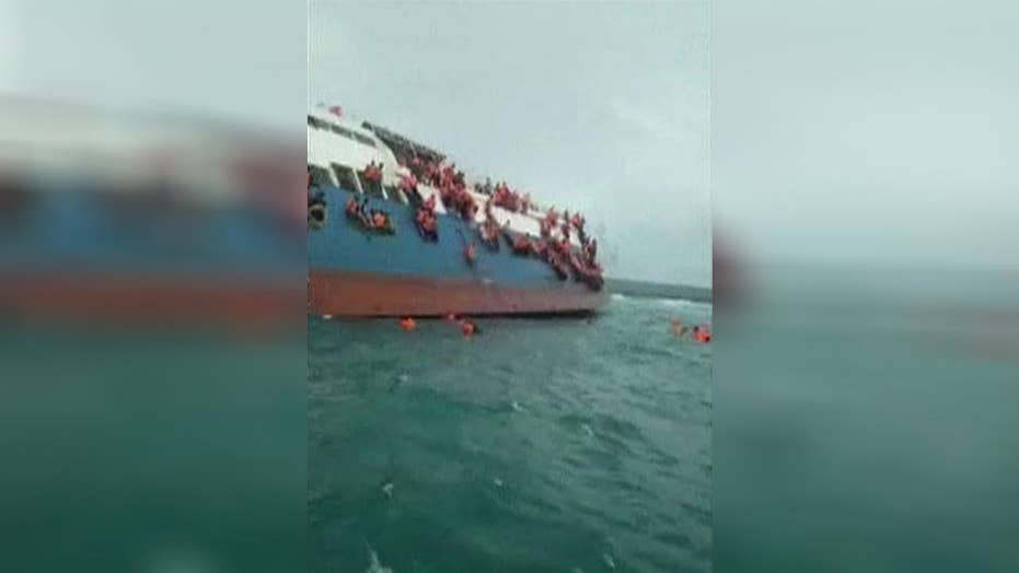 Crews rescue passengers from sinking ferry off Indonesia