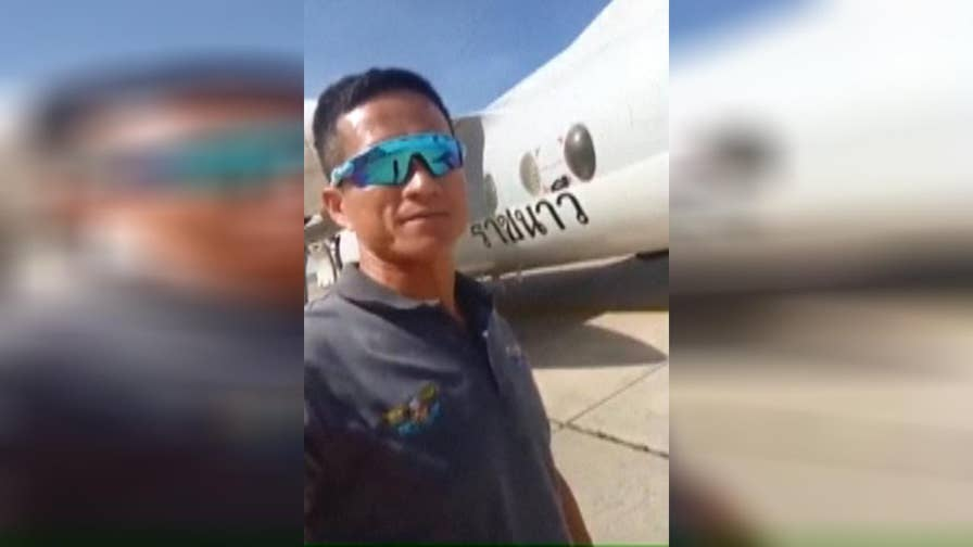 Raw video: Sergeant Major Saman Gunan prepares to board a plane and join rescue team.