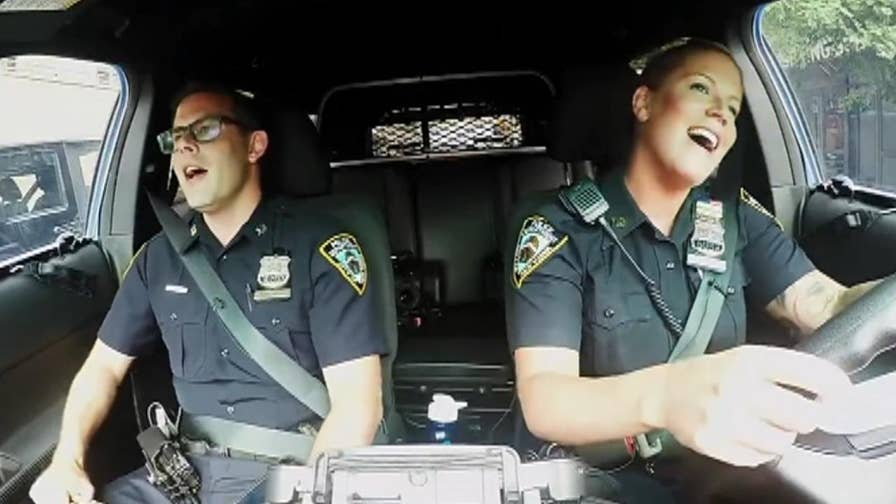 Raw video: New York's finest, inspired by Boston police officers, perform Katy Perry's 'Fireworks' while riding around in their cruiser.